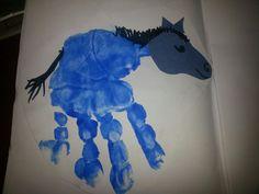 Hand print blue horse