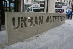 Concrete signage outside Urban Outfitters by Retail Week Images, via Flickr