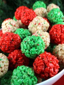 Christmas Rice Krispie Treat Bites - Yummy, bite-sized balls of crunchy, marshmallow-y delight. This is a Christmas Dessert that is easy to make and even better to eat. These colorful and festive Christmas Treats will definitely stand out on a Christmas Dessert Table. They would be great as a Holiday Party dessert or a snack for a school Christmas Party. Follow us for more fun Christmas Food Ideas.