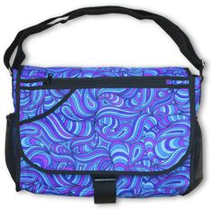 "Messenger Bag : Blue Splash  UV active shoulder bag with 7 pockets / compartments.  Strong & light, but large enough to carry your files, books & a 15"" laptop.  Chunky clip to secure the bag flap.  3 Internal & external zip pockets.  2 side pockets & another in the flap for quick access to drinks, maps, keys etc.  Secret stash pocket ! (Can you find it ?)"