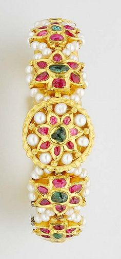 Indian Gold, Foiled Back Ruby and Emerald and Pearl Bangle Ap. 64.8 dwt. gross. Inner cir. 6 inches.