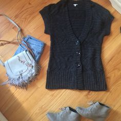 Dark grey sweater Long dark grey sleeveless sweater. Only worn a couple times. Super soft and pretty hefty for the harsh winters. Looks super cute with blue jeans and a belt! Feel free to make an offer Halogen Sweaters