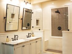 Oil Rubbed Bronze Fixtures, White Vanity, White Tile, And Marble Counter