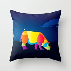 Paper Craft Rhino throw pillow. Colorful, fun and whimsical portrait of an Indian (Java) Rhinoceros grazing as the sun rises. A snowy egret rests comfortably on its back.