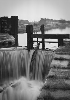 """Image by Gerry Smith from Dublin Inner City, 1980's.  Royal Canal lock.  """"Shay, Phil, MANU FC, Liverpool FC"""""""