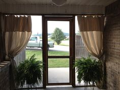 DIY outdoor curtains... With drop cloths, steel pole, and hook rings! Thank you Mom!