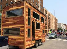 Top 10 Design Ideas for Tiny Houses on Wheels: compost toilet, aerodynamics, balance the load, secure everything with latches, multi-tasking tools, collapsible furniture, use vertical space, high quality windows, curtains instead of partition walls, road worthy
