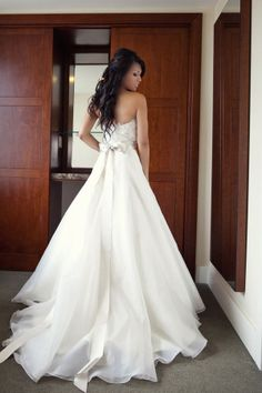 Vera Wang. He says its NOT too poofy. I repeat, NOT too poofy!! :)