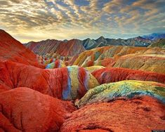 This incredible image of China's Rainbow Mountains show rock formations that actually exist here on Earth. These colorful mountains are part of the Zhangye Danxia Landform Geological Park in Gansu, China. Rainbow Mountains China, Colorful Mountains, Zhangye Danxia Landform, Places To Travel, Places To See, Travel Destinations, Places Around The World, Around The Worlds, Formations Rocheuses