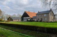 Typical Dutch farm in Flevoland, with special concrete shed by A.D. van Eck Build between 1948-1954 #Schokland, Flevoland, Noordoostpolder, Netherlands Modern architecture