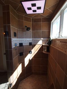 The Kohler DTV Shower System. The rain shower head lights up in different colors. This is hooked in to the owners computer to allow iTunes to be controlled from the control panel in the shower.