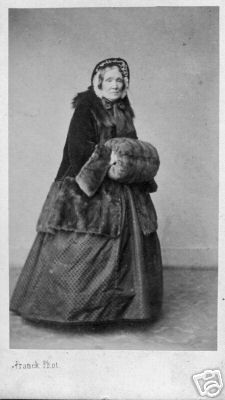 civil war era lady in fur muff.  It is fun to say muff.  Muff muff muff.