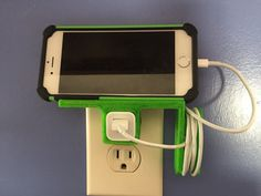 This allows you to sit your phone horizontally above the charger. Ideal for reading cooking recipes on you phone! Also in the design is a cord wrap.