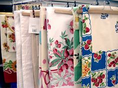 vintage style tablecloths, love.  My grandmother always covered her table with a cloth just like these