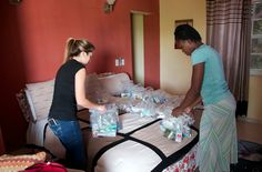 Preparing hygiene packs along with MADI apparel underwear to distribute to the women.