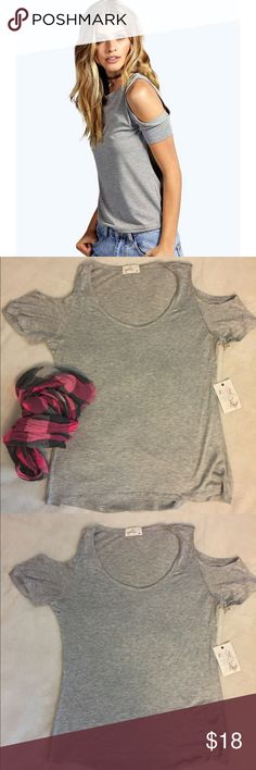 Tee | Cold shoulder style Beautiful and soft T-Shirt with cold shoulders style. 95% rayon and 5% spandex. New with tag. Smoke and pet free home. Size is marked as xl but it run super small so it will be more like a Medium size (8-10).💧 Glitz Tops Tees - Short Sleeve