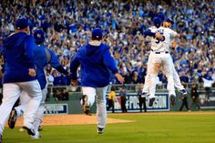 Oct 15, 2014; Kansas City, MO, USA; Kansas City Royals players celebrate on the field after defeating the Baltimore Orioles in game four of the 2014 ALCS playoff baseball game at Kauffman Stadium. The Royals swept the Orioles to advance to the World Series. (Denny Medley-USA TODAY Sports)