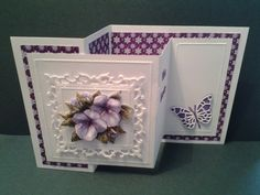 handcrafte greeting card featuring Spelbinder Fleur De Lis Squares in paars ... looks like a double Z fold ... absolutely gorgeous shaped paper violets grace the top layer ...
