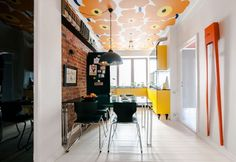 The strong accent of the minimalist and Scandinavian interior is supported by the use of some materials, including the concrete and mirror on the ceiling beam. The floral design painted on the ceiling is inspired by a finish design brand called Marimekko. Scandinavian Interior Design, Home Interior, Apartment Interior, Yellow Kitchen Cabinets, Modern Room Design, Wallpaper Ceiling, Plafond Design, Creative Decor, Residential Architecture