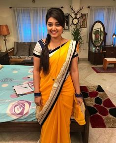 In a yellow color saree with black color border and short sleeve blouse design Beautiful Girl Indian, Beautiful Saree, Beautiful Indian Actress, Saree Draping Styles, Saree Styles, Hot Actresses, Indian Actresses, Saree Hairstyles, Actress Priyanka