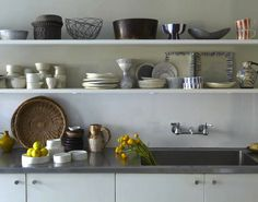 Kitchen shelves - the home of Paula Greif.  Photography by Anita Calero and Gemma Comas.