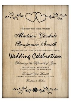Rustic Country Vintage Double Hearts Wedding Invitations with a faded wood background.  The two intertwined hearts have a floral accent.  These are great for country weddings.  #wedding