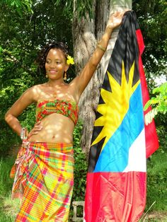 """Antigua and Barbuda. This splendid fabric which adorns our locals is called the """"Madras"""" and the bright, yellow sun on our beautiful flag represents the """"Dawn of a New Era"""". Caribbean Flags, Caribbean Sea, Beautiful Islands, Beautiful World, Beautiful People, Native Wears, World Thinking Day, Carnival Costumes, Island Girl"""