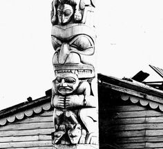 The Star House belonged to Chief Anetlas. This details the crest of a bear who is holding a human figure that is standing on two bear cubs.