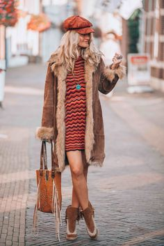 Bohemian chic look with a vintage coat and striped dress by FreePeople  Bohemian Gypsy 2df3040991e