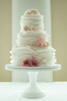 Round Romantic Ruffled Wedding Cake with ombre roses
