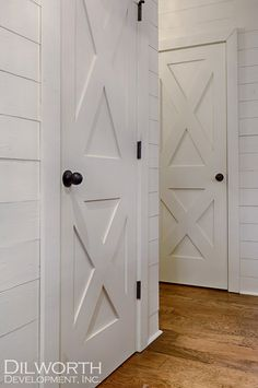 pantry door style- a little TOO barn looking. Maybe just X on the bottom and a little more detail to match cabinets... do not like this hardware- too boring.