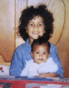 "a young ""Slash"" (Saul Hudson) of Guns N' Roses with his younger brother, ""Ash"" (Albion Hudson). He was given the nickname ""Slash"" by family friend Seymour Cassel, because he was ""always in a hurry, zipping around from one thing to another."" He is of African American and British descent."