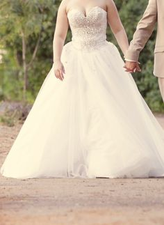 This strapless ball gown style wedding dress has a pretty blinged out bodice. We can make custom #weddingdresses like this for you with ease. Changes to any design is not an issue. In addition to custom designs that you can afford we also make #replicaweddingdresses too that look like the original but cost less. Brides can obtain pricing on any design they love from us when you contact us directly at www.dariuscordell.com