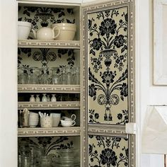 Kitchen armoire lined with toile fabric. Lovely.