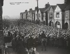 A photograph showing the scene after a stampede for tickets to watch Manchester United, taken in February 1950 by Roland Hicklin for the Daily Herald.    The photographs shows a View of Railway Road, Old Trafford, with crowds waiting for tickets to see Manchester United.
