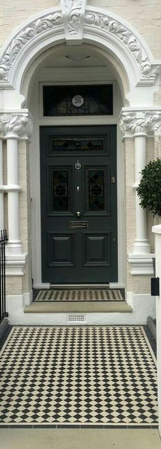 A Black door salutes this London front garden black and white victorian mosaic tile path yorkstone step Front Door Paint Colors, Painted Front Doors, Paint Colours, Victorian Front Doors, Victorian Homes, Victorian Front Garden, Victorian London, Amazing Architecture, Architecture Design