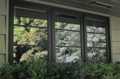 Triple casement window in forest green.