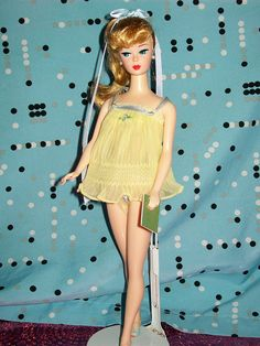 My Barbie had this! I think hers was pink??? We only rarely had purchased outfits (we sewed our own - everybody did) but this was a necessity of life!1959 Sweet Dreams Barbie -