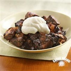 Triple-the-Chocolate Bread Pudding from Eagle Brand®        Crisco® Original No-Stick Cooking Spray      1 can PillsburyGrands cinnamon rolls w/icing      1 (14 oz.)  Sweetened Condensed Milk      1/2 c  semi-sweet chocolate baking chips      1/4 c Hershey's baking cocoa      1/2 c milk      2 t instant coffee granules or crystals      2 t McCormick® Pure Vanilla Extract      3  Eggs      2  Egg Yolks      3/4 c Hershey's® Special Dark® syrup      1 c heavy whipping cream