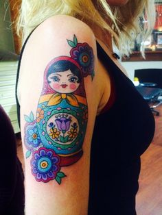 Really like the eyes and bright colors and how the background has kind of Polish esque style flowers. Would swap out the purple centre flower for a blue bird. Time Tattoos, New Tattoos, Sleeve Tattoos, Cool Tattoos, Tatoos, Beach Tattoos, Babushka Tattoo, Russian Doll Tattoo, Nesting Doll Tattoo