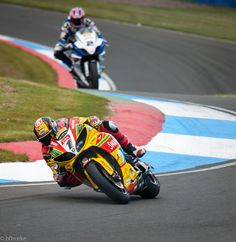 One, Two. Tommy Hill in his Swan Yamaha leads over Josh Brookes