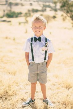 This is a great look for the ring bearer or junior groomsman for a family vow renewal. suspenders have never looked so adorable // photo by The Robertsons