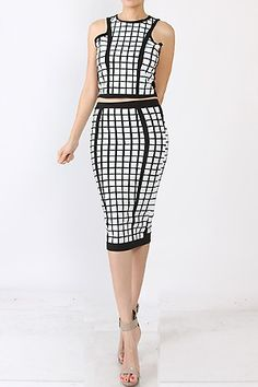 This eye-catching black and white checkered styled crop top and matching two piece skirt set. Features Black and White Checkered Pattern Crop Top High Waist Midi Skirt Zip Closure Occasion Casual Wear Wear to Work Cocktail 95% COTTON, 5% SPANDEX