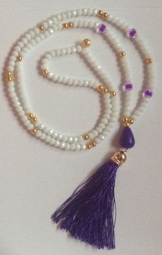 white & gold necklace with tassel