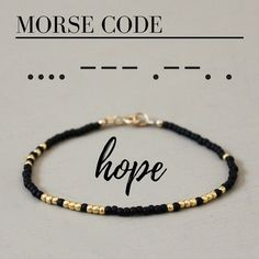 A fun and simple beaded bracelet with the word HOPE written in Morse Code! Each glass seed bead is carefully hand strung. All metal components are 14K Gold fill.