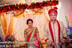 Bride and Groom Portrait at Indian Wedding in the Skylands, Nj. Gujarati Wedding. Bridal Makeup by Cinderella Bridez. Best Wedding Photographer PhotosMadeEz, Award winning photographer Mou Mukherjee. Couples Choice Award Winner