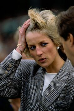 Princess Diana at European Horse Trials  Princess Diana pushes her hair away from her face at the European Horse Trials near Burghley House.  Image: © Tim Graham/CORBIS  Photographer:Tim Graham  Date Photographed:September 10, 1989  Location Information:Stamford, Lincolnshire, England, UK