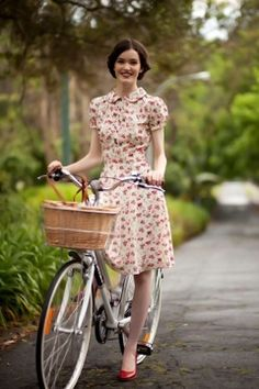 The floral dress with peter pan collar, the bike with the basket - couldn't be more you!