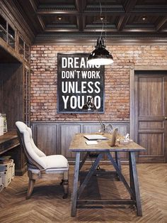 Distressed grey wood wainscoting and used brick wall, herringbone pattern wood floor, worn wood table office desk, and comfy chair.