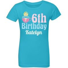 Cute 6th Birthday Tea Party T-Shirt A pretty sixth birthday outfit with a little girl turning 6 sitting in a cute polka dot teacup next to light pink and baby blue writing. Personalize it with your child's name! A great kindergarten birthday party theme. #teaparty